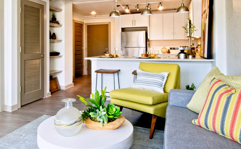 Living room open to kitchen with an eat-in bar